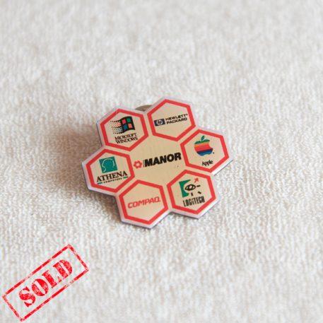 Manor multi-brands Switzerland Apple computer lapel pin